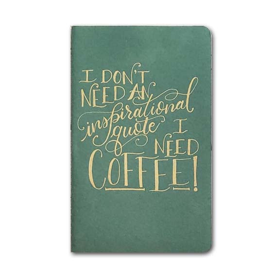 hand painted journal that says I don't need an inspirational quote I need coffee in gold lettering on the evergreen journal.