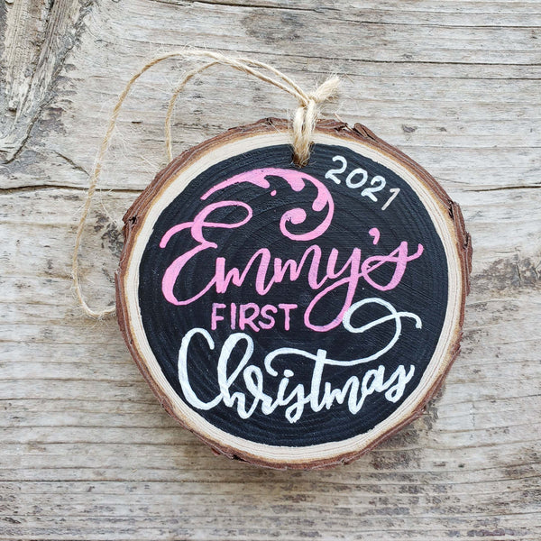 rustic wood slice ornament that says baby's name first Christmas 2020