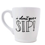 16 oz hand painted white ceramic coffee mug that says i don't give a sip in black hand lettering