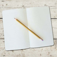 image of inside of journal with lined pages and a pencil