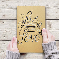 hand painted journal that says love what you do do what you love in black and white on kraft journal