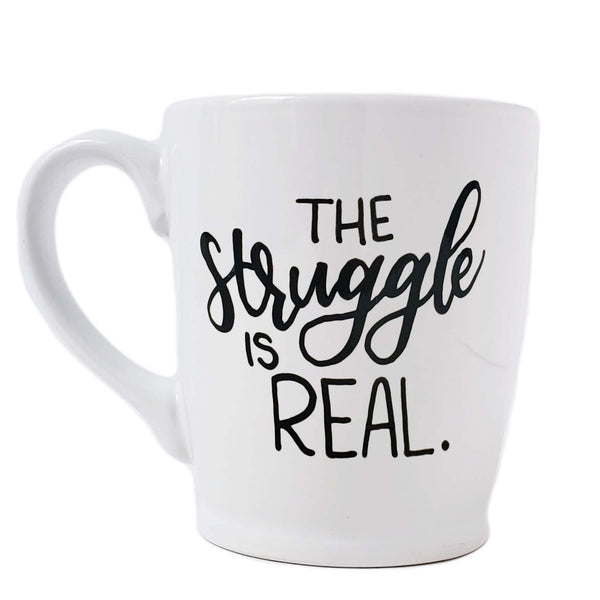 16 oz hand painted white ceramic coffee mug that says the struggle is real in black hand lettering