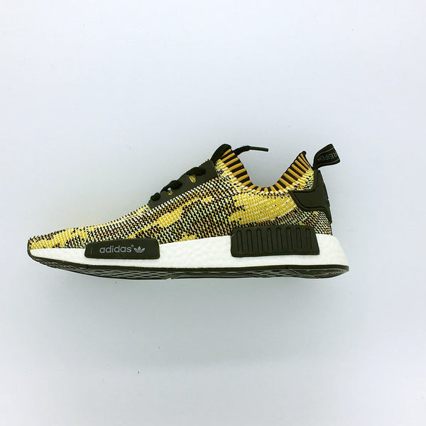 "Adidas NMD Runner Primeknit ""Core Black/St Nomad Yellow""."