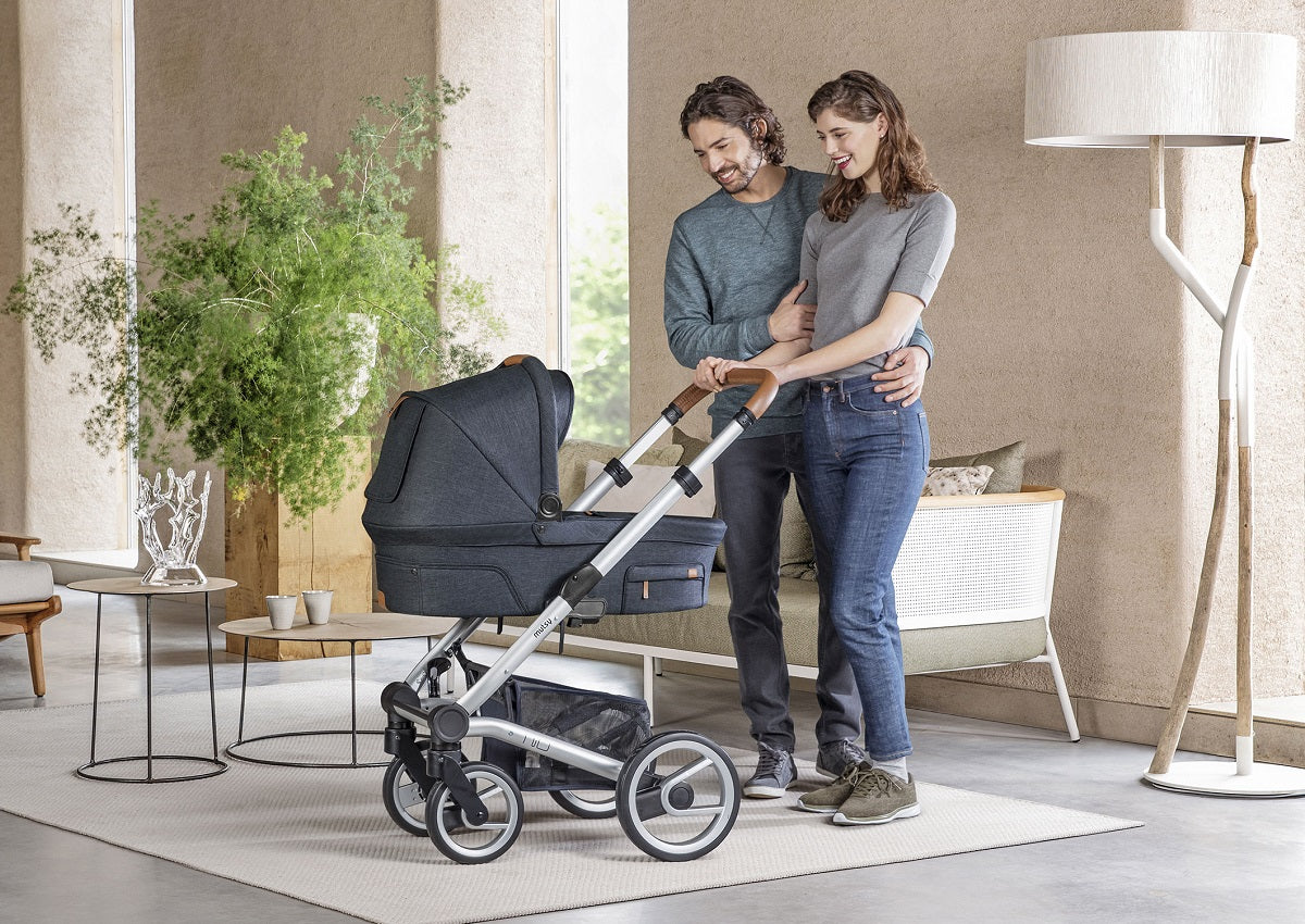 Parents with Mutsy Nio Pram