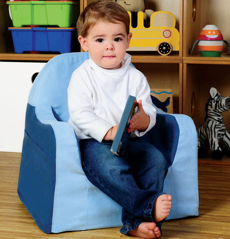 Toddler sitting on a soft seat