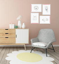 Nursery chair and dresser with cute pale pink picture frame set
