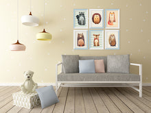 Nursery room with cute animals pictures in white and blue picture frame set