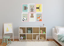 Kids bedroom with picture frames and animal head prints