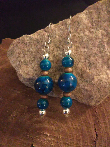 Glass and wood bead earrings chained and twisted
