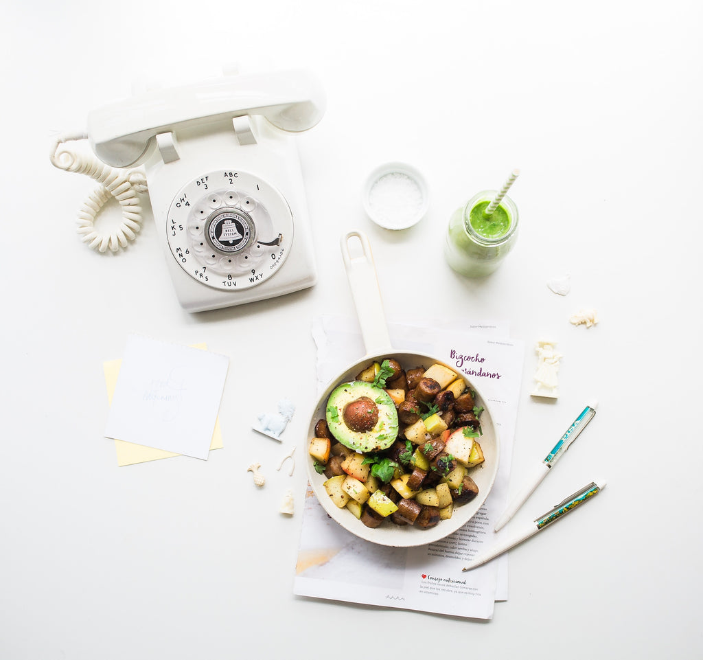 bowl of vegetables with a white phone