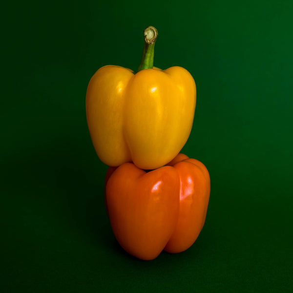 yellow pepper stacked on top of orange pepper