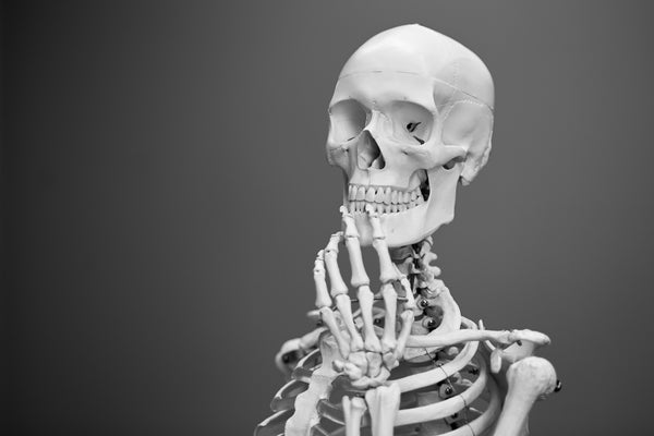 skeleton with fingers on chin