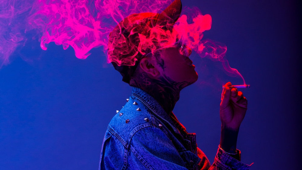 man smoking colorful pink smoke