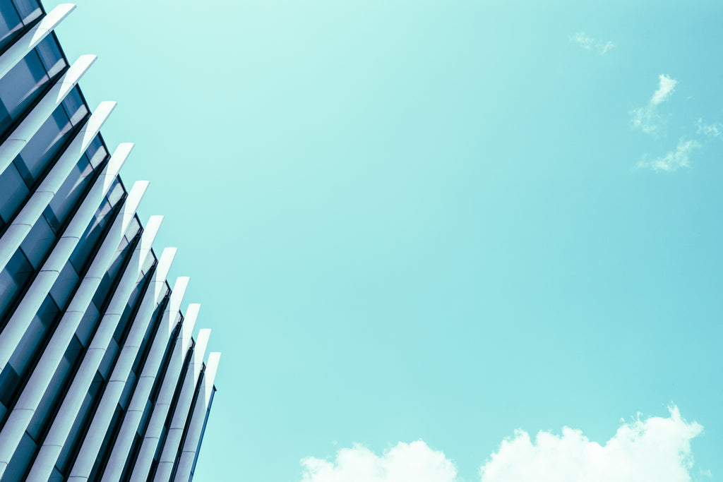 edge of building against bright blue sky