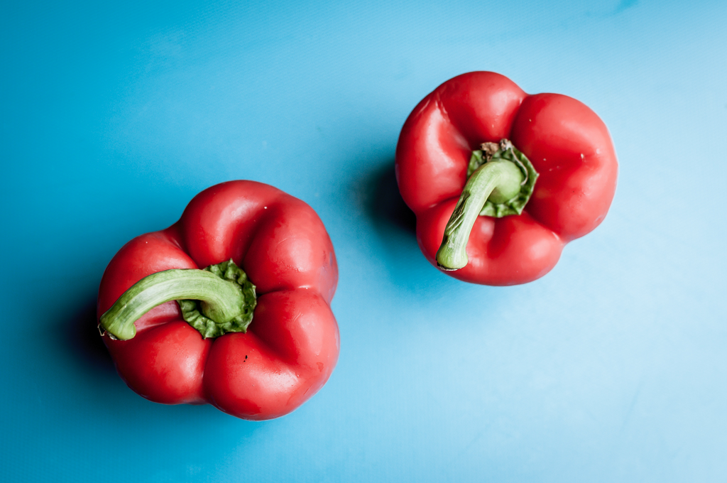 red bell peppers on a blue background