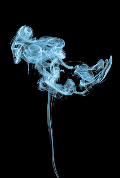 curl of blue smoke on a black background