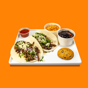Individually packaged Brisket Taco meals from Big Box Catering