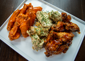 Wing Platter featuring Buffalo Sauce, Lemon Pepper Sauce, and BBQ sauce