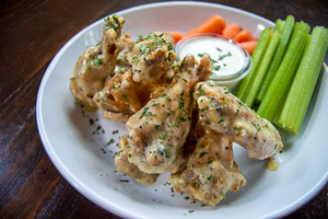 Wing Platter with Lemon Pepper Sauce, ranch, carrots, and celery