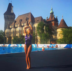 Philicia posing by the poolside in Budapest