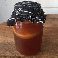 Small batch brewing jar with Kombucha in it by YEABUCHA