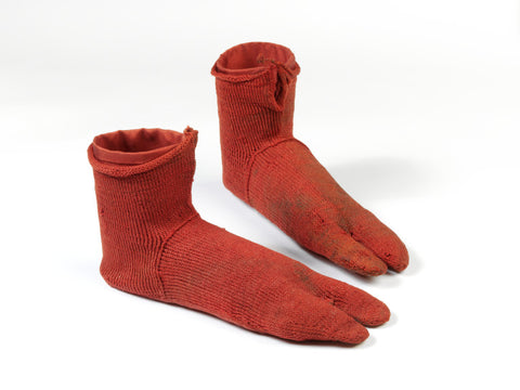 The earliest known surviving pair of socks are a bright red-orange with split toes