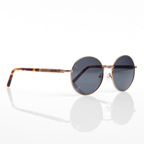 Round sunglasses with tortoise shell frame.