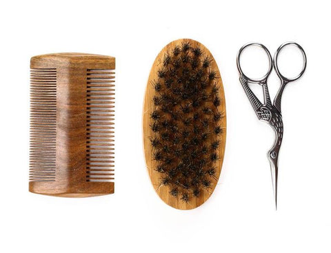 Our 3 piece grooming set featuring trimming scissors, a comb, and beard brush