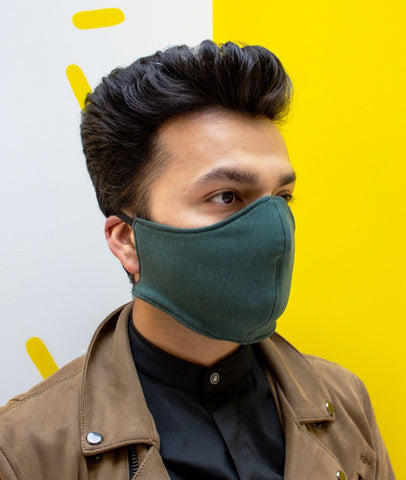 Ayaz Raja, co-founder of adesso, wearing an army green face mask