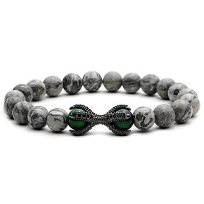 a grey beaded bracelet with green accents
