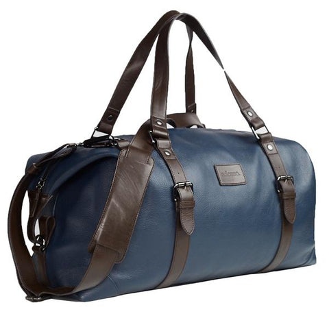 The Roberto Modern Duffle Bag in indigo leather with brown leather straps and detailing