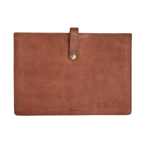 Our minimal leather laptop sleeve in buffalo with a simple snap closure