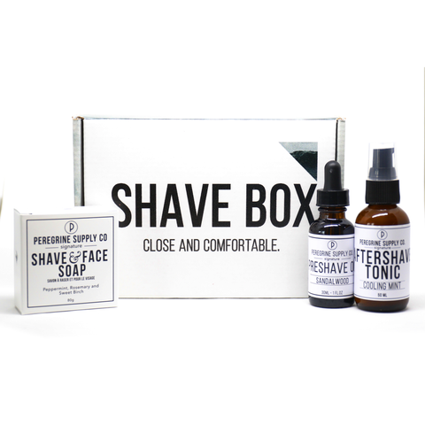 The Peregrine Supply Co. Shave box contains a bottle of pre-shave oil, a bar of shave and face soap, and a bottle of tea tree oil aftershave tonic