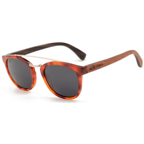 a pair of rounded sunglasses in brown