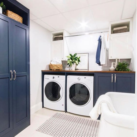 A sustainable laundry room with clothes hanging to dry