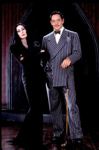 Anjelica Huston and Raul Julia as Morticia and Gomez Addams