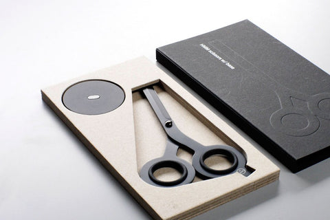 Scissors from the HMM project lay in their box