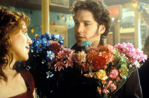 Paul Rudd in 200 Cigarettes giving Courtney Love a bouquet of flowers