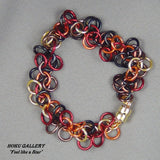 Random mix of Yellow, Orange, Red, Brown, and Black Anodized Aluminum Rings, Bracelet