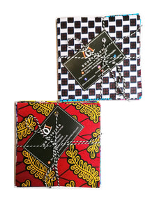 Two packs of quilting squares charm packs. 42 5 inch by 5 inch squares in each pack.  One of the packs in the image has a black and white chequered design as the top fabric, the other pack has a red and gold design as the top fabric.