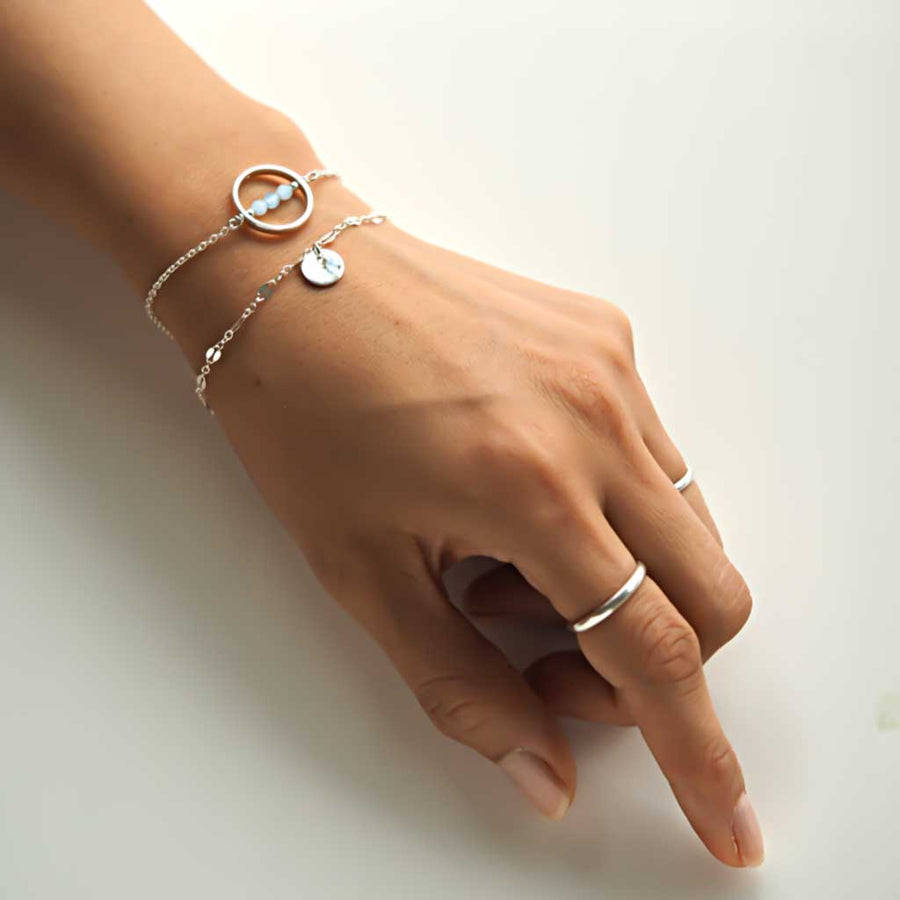 Hand model wearing Halo MOP and Unity  Bracelets Silver2