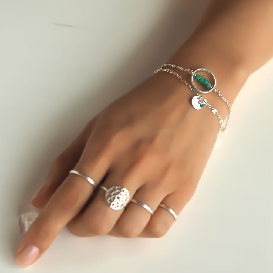 Hand-model-wearing-Halo-Turquoise-and Unity bracelet-and-dandelion-ring