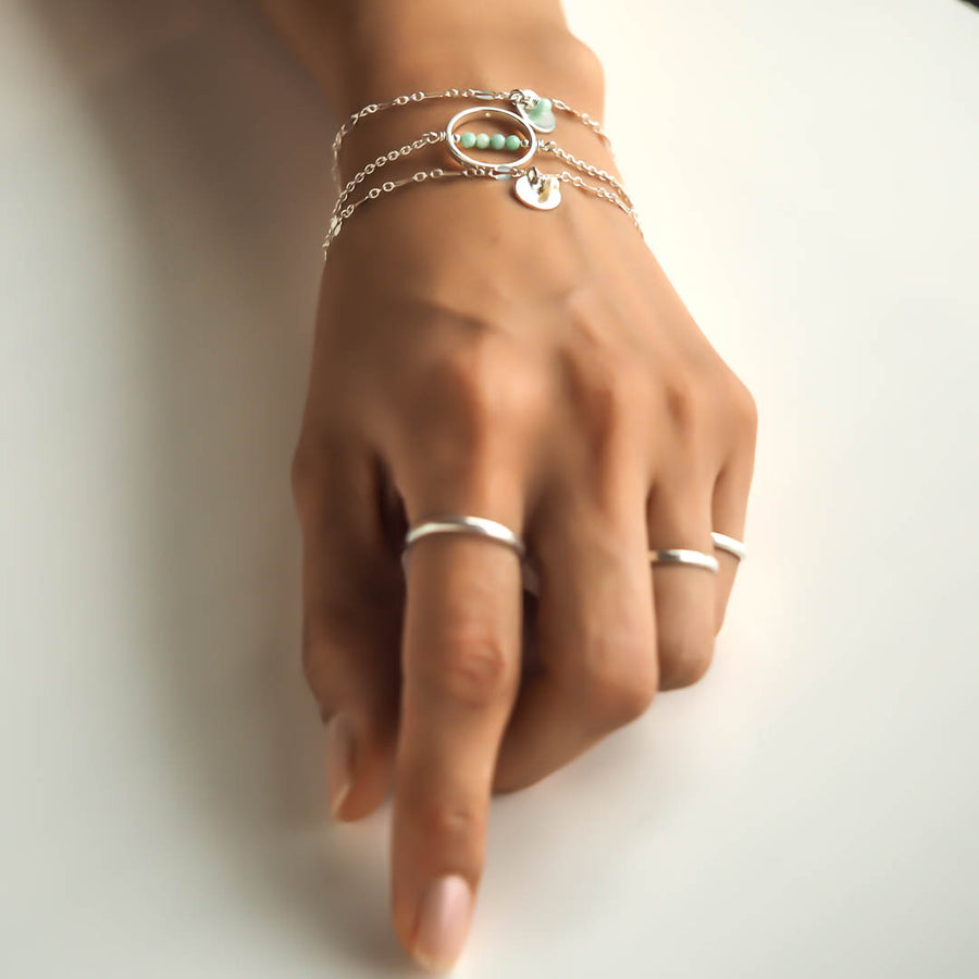 Hand model wearing Halo MOP and Unity  Bracelets Silver1