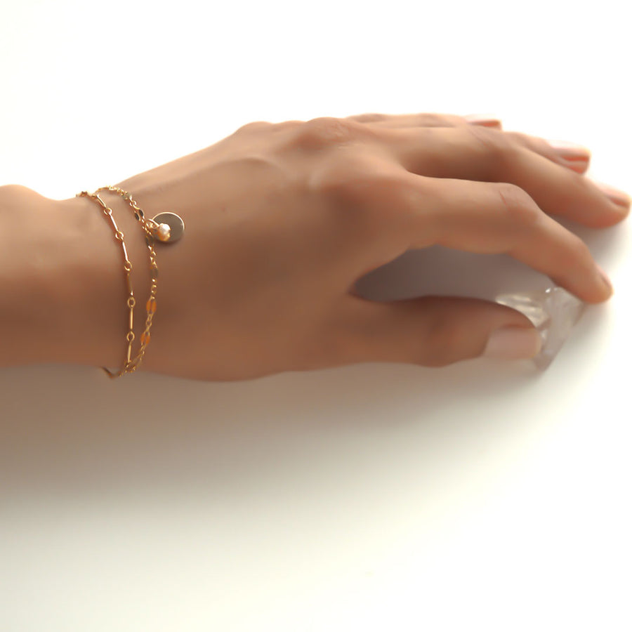 Hand model wearing Unity Bracelet - Gold and Amethyst
