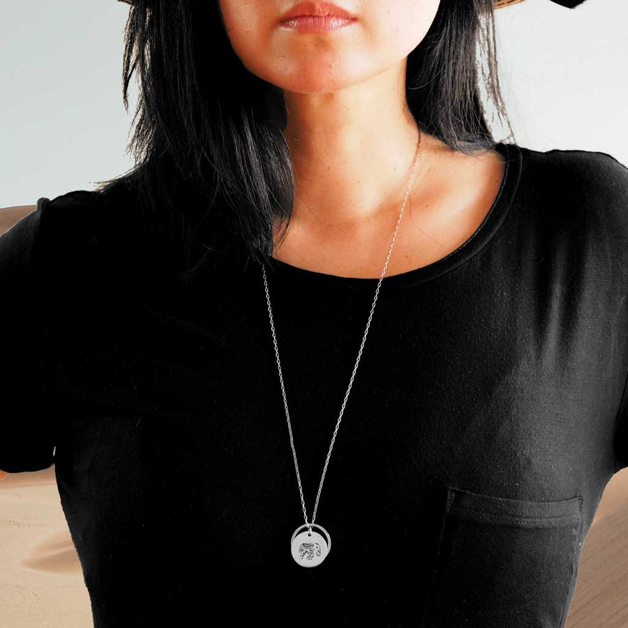 Model wearing Enchanted Elephant and Ring of Fire Rhodium long chain