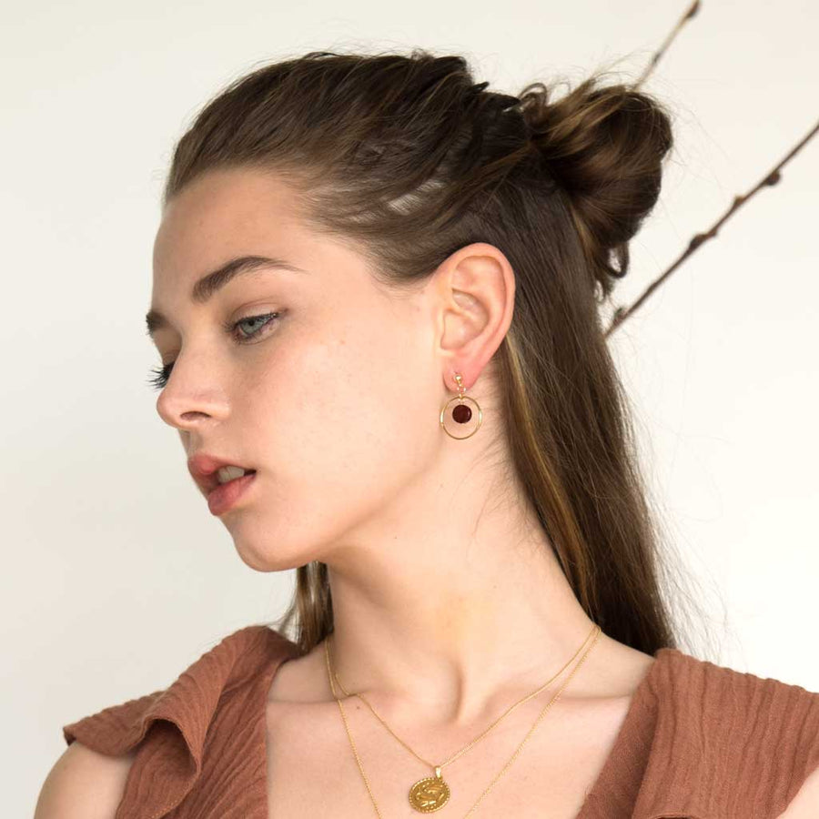 Model-wearing-Halo-Sunrise-Earrings-and-Gold-pisces-necklace