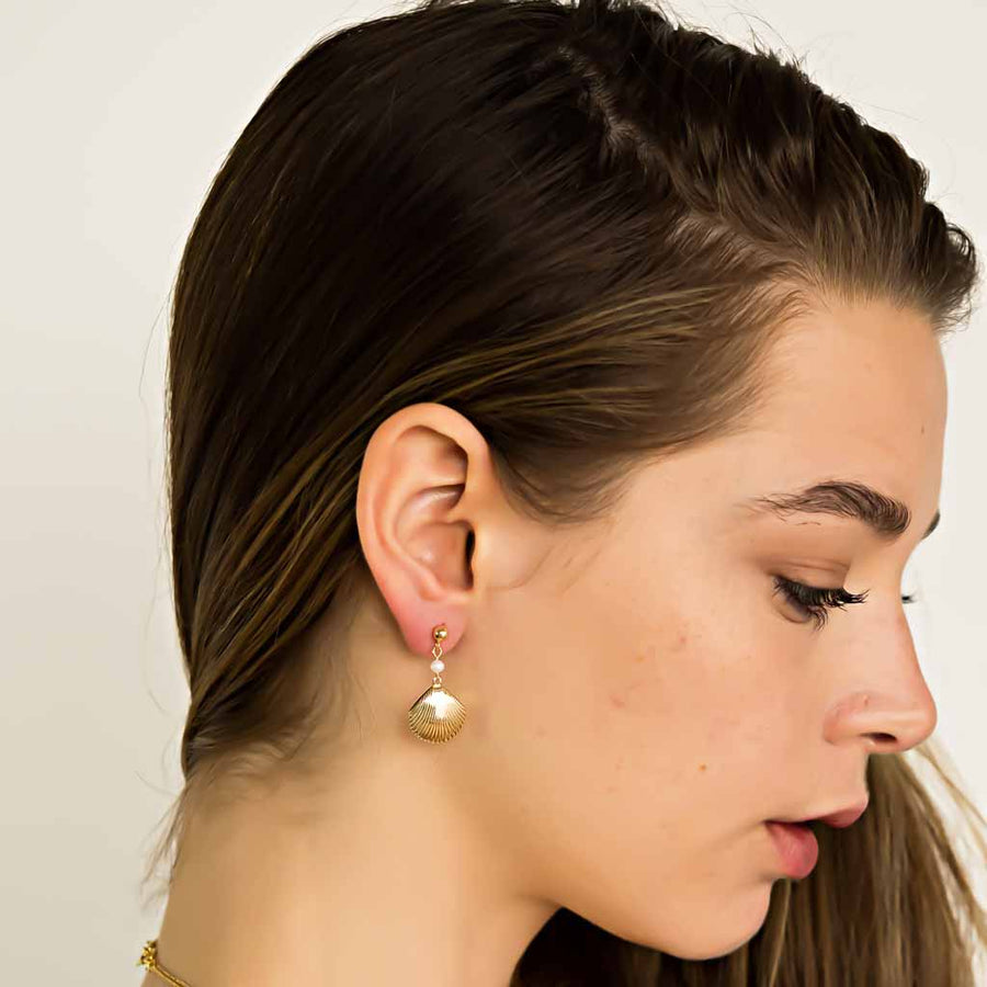 Model wearing Impressions Golden Shell Earrings - Gold and Pearl