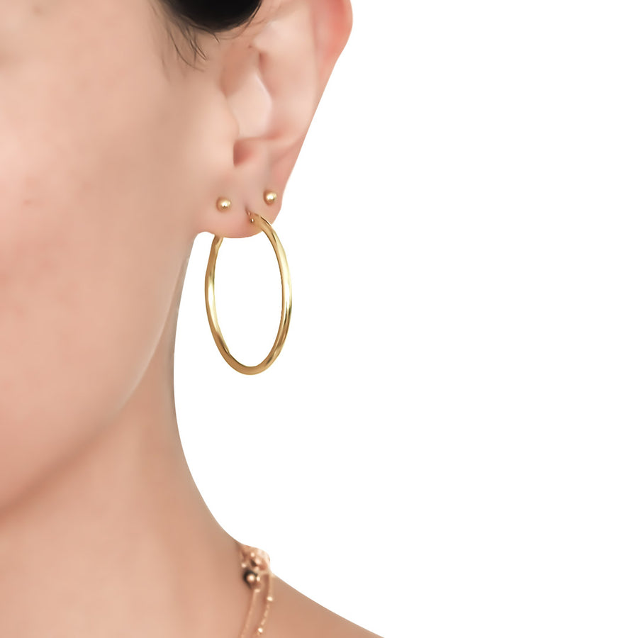 Model wearing Perfect Hoop Earrings - Gold