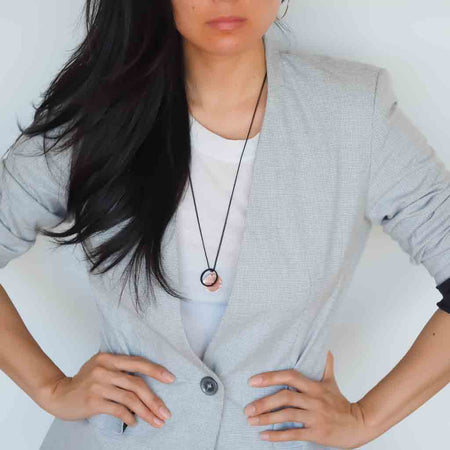 Model wearing Alpha and Triangle Elements pendant