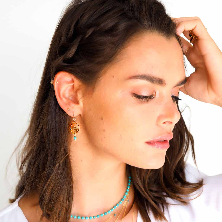 Model wearing Baby Lotus Earrings Gold and Amazonite
